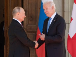 Biden Makes Silly Face While Shaking Hands with Putin vwcbeM