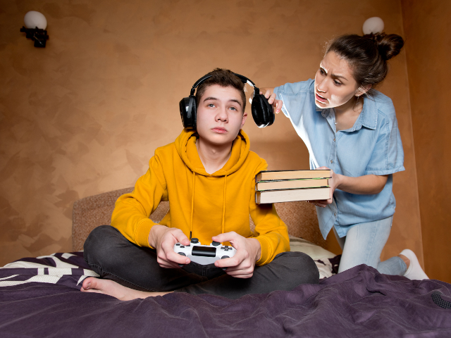 Teenager playing video games D5preC